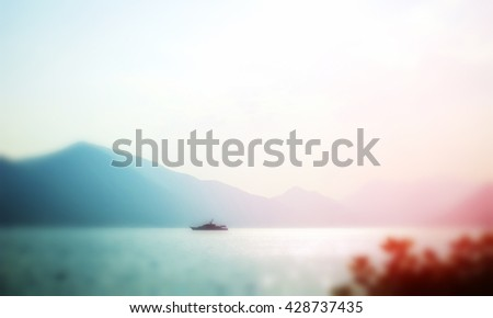 Defocused image, the lonely ship at the sea,  soft blurred - stock photo