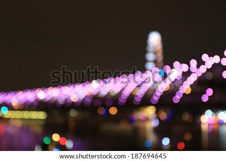 Defocused Lights Helix Bridge in Singapore - stock photo
