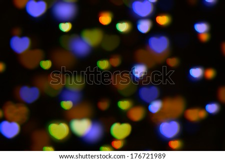 defocused  lights in the shape of hearts - stock photo