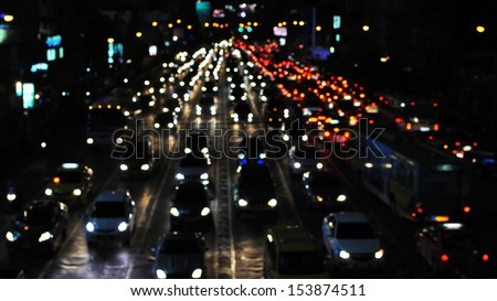 Defocused Lights of Gridlocked Traffic on a Busy City Road at Night - stock photo