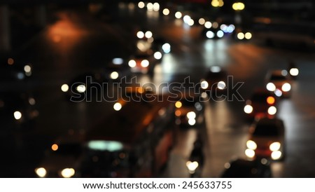 Defocused Lights of Heavy Traffic on a Busy City Road at Night - Image Has Soft Focus - stock photo