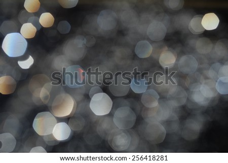 Defocused lights spots of different color. Blurred water drops bokeh. - stock photo