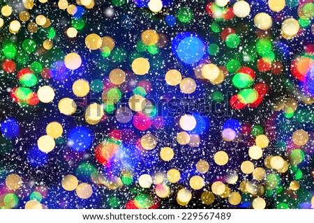 defocused lights with snowfall effect. winter night at the city. abstract black white background - stock photo
