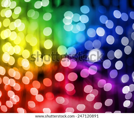 Defocused multicolored Christmas lights ideal for backgrounds - stock photo