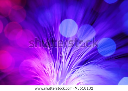 Defocused Optical fibers of fiber optic cable. Internet technology.  See my portfolio for more - stock photo
