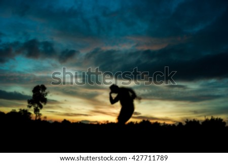 Defocused or Blurred of Fitness on silhouette sunrise A man workout wellness concept. - stock photo