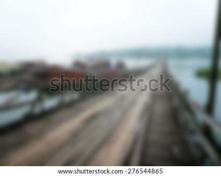 defocused photo of wooden bridge, perspective - stock photo