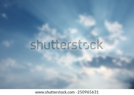 Defocused Ray Of Lights Through The Clouds
