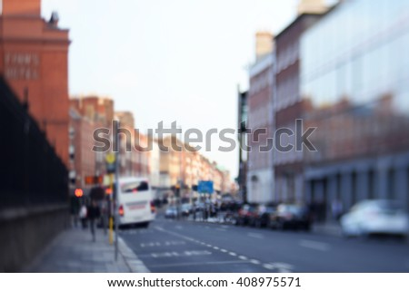 Defocused road side. blurred background street with houses and cars, bus, people. urban scene - stock photo