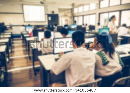 Defocused student study computer classroom for background.VIntage or retro tone. - stock photo