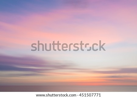 Defocused sunset sky and ocean nature background with blurred panning motion. - stock photo