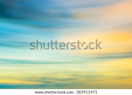 Defocused sunset sky  natural background with blurred panning motion. - stock photo