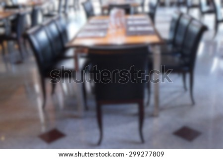 Defocused table with glassware in dining room - stock photo