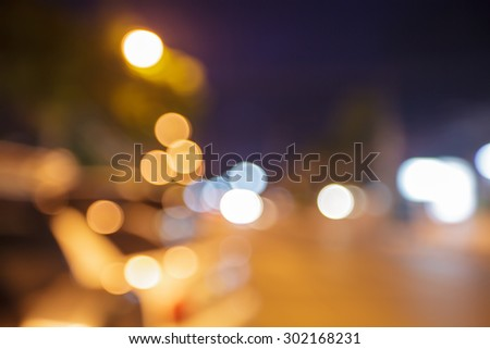 Defocused urban abstract bokeh city lights  background with blurring lights with Motion Blur - stock photo