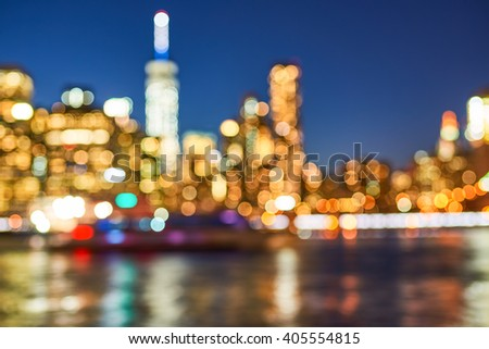 Defocused view of New-York City downtown from Brooklyn at evening - stock photo