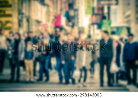 Defocused vintage toned pedestrians at crosswalk intersection in Manhattan New York City - stock photo