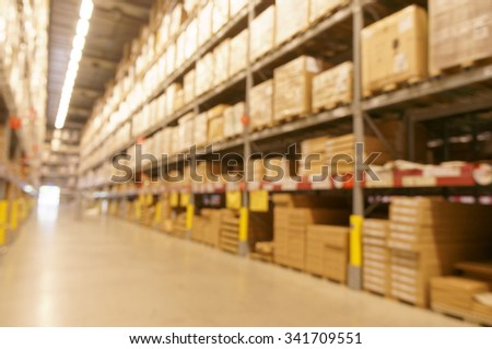 Defocused warehouse with multi-layer shelves - stock photo