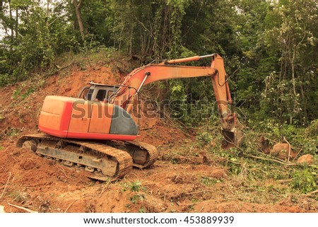 Deforestation: Borneo tropical rainforest is destroyed for oil palm plantations and human development. - stock photo