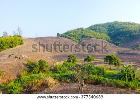 Deforestation on the mountain for agriculture in Chiang Rai, Thailand. HDR - stock photo