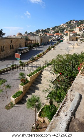 Deir el-Qamar: The historical village of Deir el-Qamar in the mountains of Lebanon, with its traditional style red tiled roof houses, ancient mosque and village square now a major tourist destination - stock photo