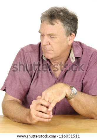 Dejected and depressed middle aged man looks away from camera.