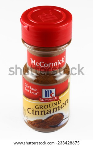 DeLand, FL, USA - November 25, 2014: McCormick Ground Cinnamon, a popular brand of ground cinnamon spice communally used in cakes, pies, and holiday foods. - stock photo