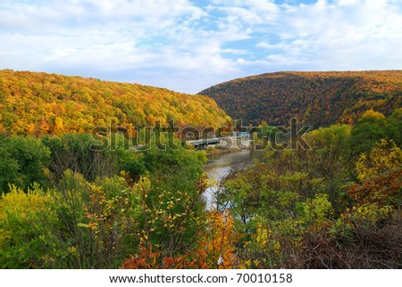 Delaware Water Gap panorama in Autumn with colorful foliage with forest and mountain over river. - stock photo