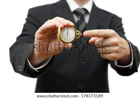 delay or late concept with businessman showing pocket watch - stock photo