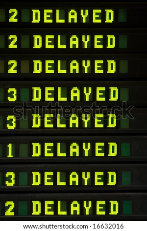 Delayed flights on the flight information board in the airport - stock photo