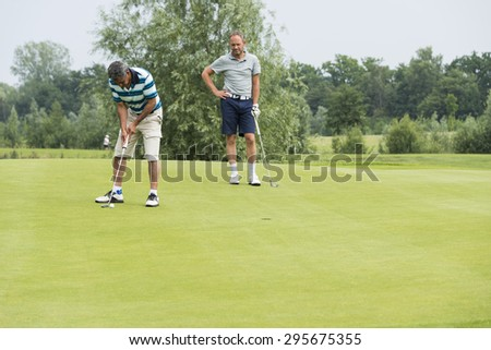 DELDEN,HOLLAND- JULI 5:Unidentified golfers participate in open golf tournement on Juli 5 2015 in Delden Holland, this game is held once a year