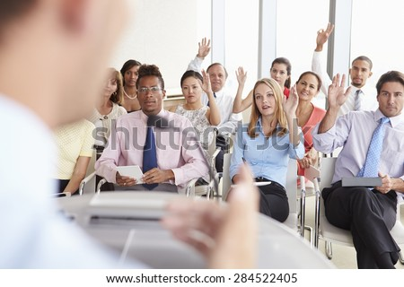 Delegates Asking Question At Business Conference - stock photo