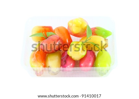 Deletable imitation fruits dessert on plastic package.