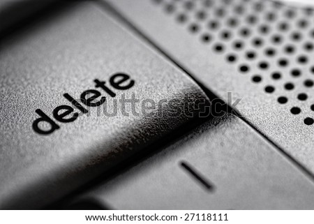 Delete key from a silver laptop - stock photo