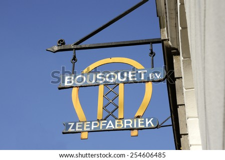 DELFT, HOLLAND-FEBRUARY 15, 2015; OId fashioned sign in the city of Delft.The signboard is hanging outside a soap factory. February 15, 2015 Delft, Holland - stock photo