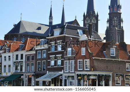 DELFT, NETHERLANDS - MARCH 25: houses, shops and towers on the main square on March 25, 2012. Delft is a city and municipality in the province of South Holland.
