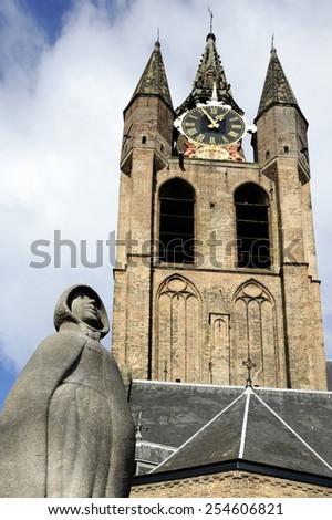 DELFT, THE NETHERLANDS - FEBRUARY 5, 2015 : Statue of Geertruyt van Oosten in front of the Oude Kerk (Old Church). February 5, 2015 Delft, Netherlands - stock photo