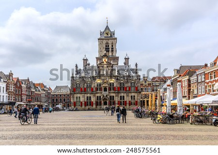 DELFT, THE NETHERLANDS - JUNE 17, 2014: City landscape of Markt (central square). Delft - beautifully preserved historic city - from a rural village in the early Middle Ages Delft developed to a city. - stock photo