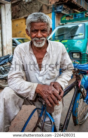 DELHI - APR 16: Unidentified Indian man on April 16, 2011 in Delhi, India. Delhi is the largest urban agglomeration in India by population. It is also the 4th most populous city on the planet. - stock photo