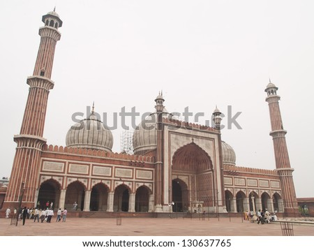 DELHI - AUG 9 :Unidentified indian tourists visiting Jama Masjid, on August 9, 2012 in Delhi, India.Jama Masjid is the largest and perhaps the most magnificent mosque in India. - stock photo