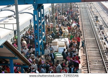 DELHI - DEC 10: Crowded train station platform on December 10, 2010 in Delhi, India. Indian railways transport 20 million passengers daily. - stock photo
