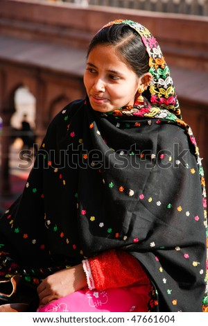 DELHI - FEBRUARY 11: Muslim woman dressed with black shawl at Jama Masjid mosque on February 11, 2008 in Dehli, India. Jama Masjid is the largest mosque in India with millions of visitors each year. - stock photo