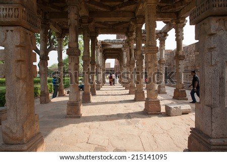 DELHI, INDIA - APRIL 13: Unidentified peoples visit Qutub Minar, World Heritage site. It's made of red sandstone. The Tower is 73 metres high and 2nd tallest tower in India on Apr 13, 2014 in Delhi.