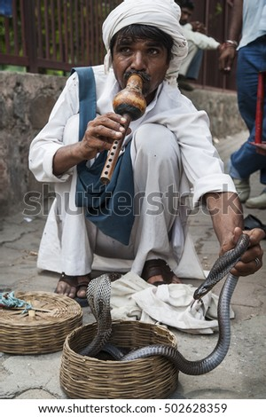 Delhi, India - August 10, 2012. A snake charmer at a street in the city of Delhi
