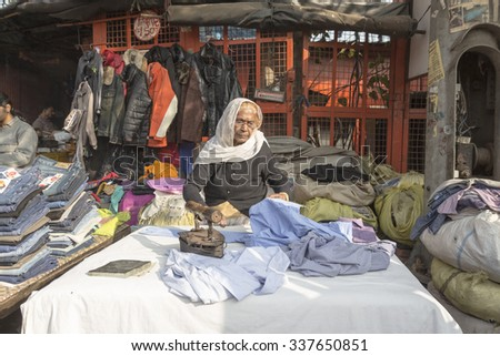 DELHI INDIA - DEC 20 : laundry stall by tradition way in old delhi. old delhi is famous place of delhi on december, 20, 2014, india