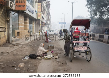DELHI INDIA - DEC 27 :  life in morning of indian people in paharganj. paharganj is big tourist hub in new delhi on december, 27, 2014, india - stock photo