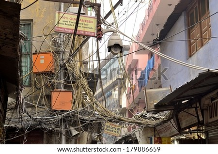 DELHI, INDIA. FEB 8, 2014. The image represents the usual mess in the street electrical wiring. - stock photo