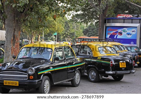 DELHI, INDIA   FEBRUARY 27, 2015: Ambassador cabs at a taxi stand. This particular model has been a feature of Indian cities for 60 years but its maker, Hindustan Motors, recently ended its production - stock photo