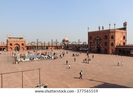 Delhi, India - February 16, 2016: Unidentified people walk in courtyard of Jama Masjid located in Old Delhi, India. The courtyard of the mosque can hold up to twenty-five thousand worshippers.
