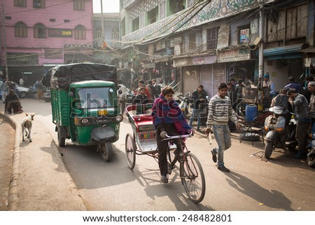DELHI, INDIA - JAN 06: An unidentified rickshaw driver on the streets in Delhi on January 06, 2015. Rickshaw men are one of the hardest working people and also poorest in the whole India. - stock photo