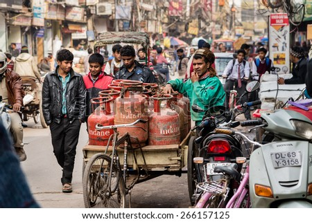 DELHI , INDIA - JANUARY 24: Crowded Indian street scene on January, 24 2015 in Old Delhi, India. - stock photo